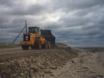 Town of Falmouth front end load working at a beach after Hurricane Floyd.