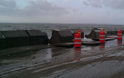Sea wall near Great Pond bridge on Menauhant Rd in Falmouth after storm